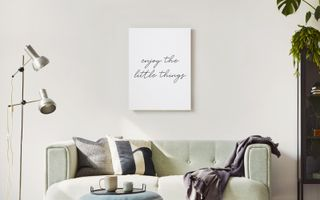 A word art print hung above a couch.
