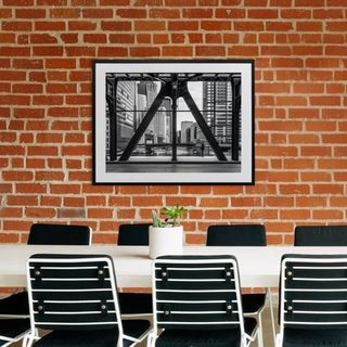 A canvas print positioned above a meeting room table