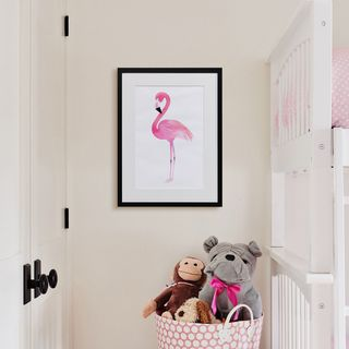 A canvas print positioned next to a kids bunk bed