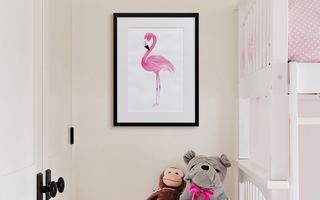 A canvas print positioned next to a kids bunk bed.