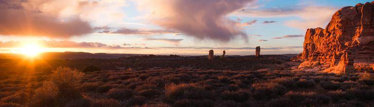 A landscape photo of the American desert as sunrise