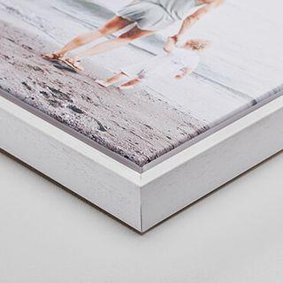 """White wood frame, 1.25"""" deep."""
