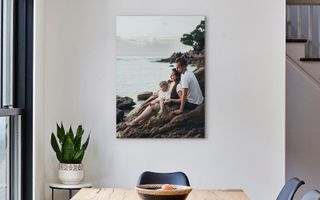 A canvas print hanging above a dining table