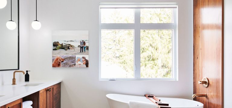 A photo collage print hanging in a bathroom.