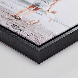 "Black wood frame, 1.25"" deep."